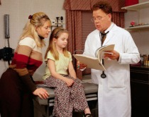 Doctor Reading Girl's Chart